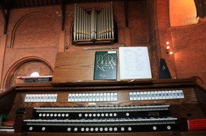 New console with the pipes of the old organ in the distance